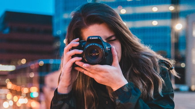 A Person Taking A Photograph